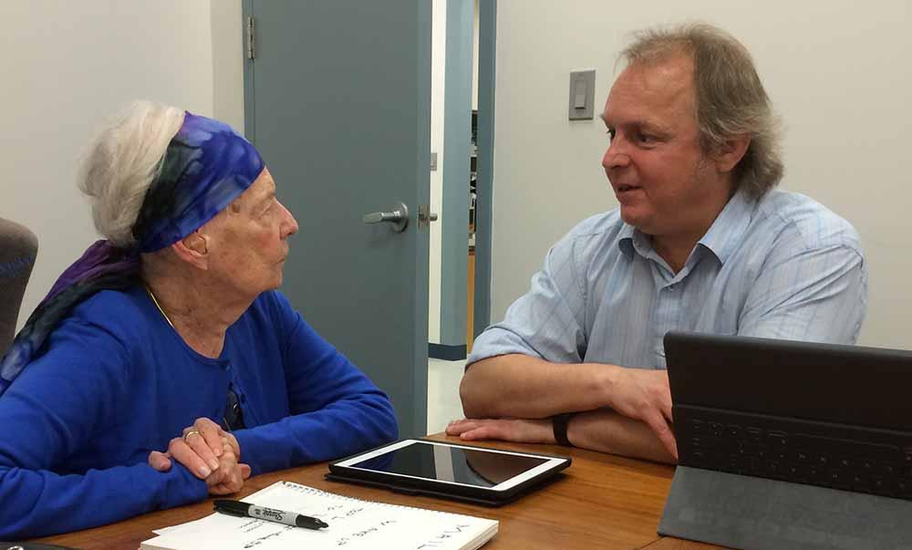 Doug Poirier talks to a client